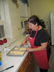Trudi Wildfeuer preparing baked goods.
