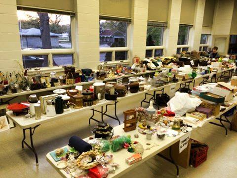 tables full of rummage sale items