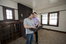 """Purdue doctoral student Stephen Caskey (left) works with professor   Eckhard Groll to convert a home near campus to the most efficient   domicile possible - a """"net-zero"""" structure. Purdue is working with   Whirlpool Corp. on the three-year project. (Purdue University   photo/Mark Simons)"""