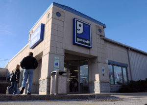 Pedestrians walk past the Goodwill store in Moline, Ill., on Wednesday, Nov. 30, 2011. Charity workers continued their search Wednesday through a warehouse of donated clothes in Iowa after an elderly man said he mistakenly donated a suit with $13,000 in a coat pocket to the Moline Goodwill store. The 80-year-old Illinois man, who has remained anonymous, notified Goodwill last week of the mistake. (AP Photo/The Dispatch, Paul Colletti) QUAD CITY TIMES OUT