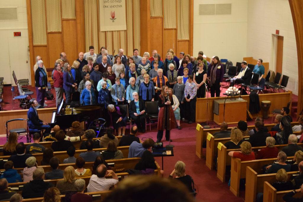 Chorus singing to congregation in sanctuary