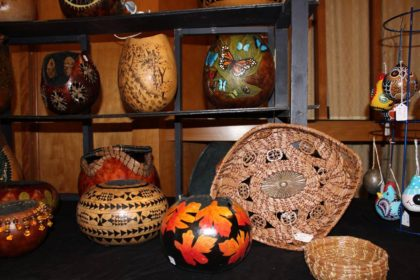 art fair display including basketry and decorated gourds