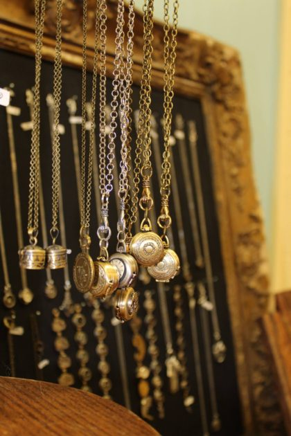 display of metal necklaces and pendants