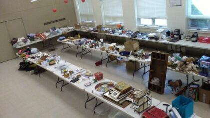 tables filled with rummage sale items